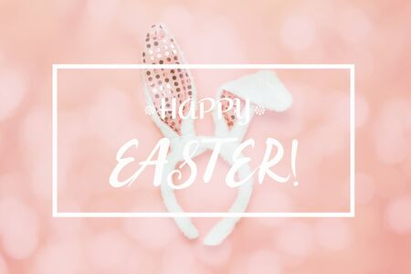 Happy Easter Text with bunny ear on modern rustic beautiful pink paper Stock Photo