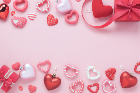 Table top view aerial image of decoration valentines day background concept.Flat lay essential items red heart & gift box on modern rustic pink paper.blank space for mock up creative design.
