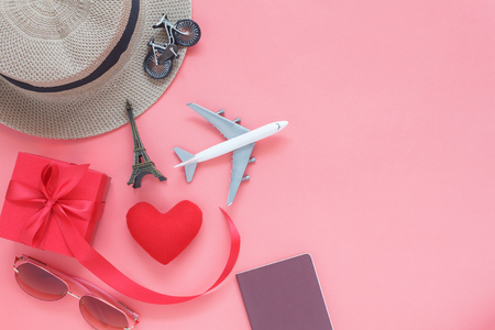 Flat lay image of accessory clothing man or women to plan travel in valentines day background concept.Passport & clothes with many items in holiday season.Table top view several object on pink paper. Stock Photo