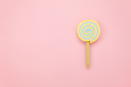 Table top view shot of arrangement food object background concept.Flat lay of sweet candy on the modern rustic pink paper at home office desk wallpaper.pastel tone creative design.