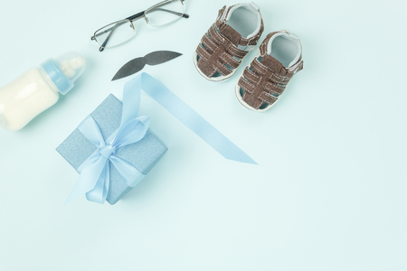 Table top view decorations Happy Fathers day holiday background concept.Flat lay gift box for dad with essential accessory objects sign of daddy season on modern rustic blue paper at home office desk. Stock Photo
