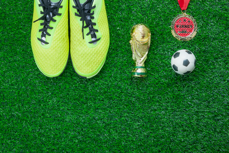 Table top view of soccer or season background.Flat lay accessories trophy