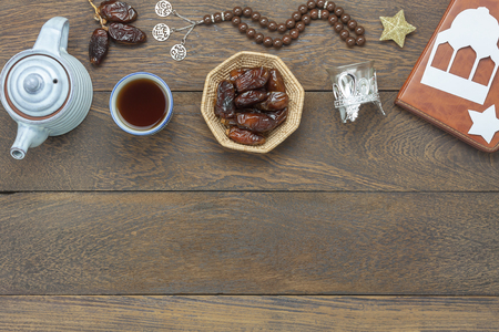 Table top view aerial image of decoration Ramadan Kareem holiday background.Flat lay date in wood basket with  rosary & green tea.Halal meal set for fasting is obligatory for Muslim on brown wooden. Stock fotó - 101190823