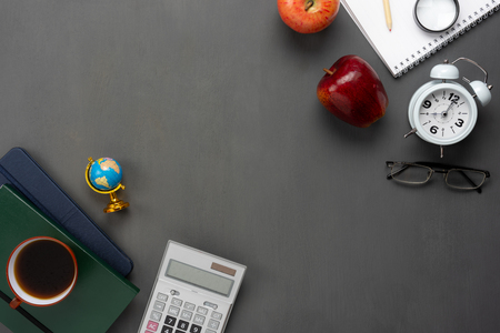 Table top view aerial image of decorations education for back to school mock up background concept.Flat lay of variety objects apple & stationary on modern rustic black wooden with copy space add text