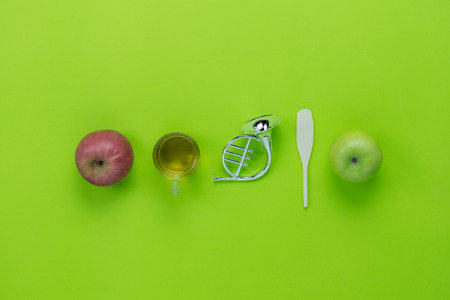 Table top view aerial image of decorations Jewish holiday Rosh Hashana background concept.Flat lay of variety  apple & honey with green leave on modern rustic white wooden.Free space for design text.