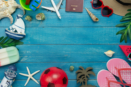 Table top view aerial image of summer & travel beach holiday in the season background concept.Flat lay essentials object accessories for traveler woman on plank blue sea wooden and copy space.