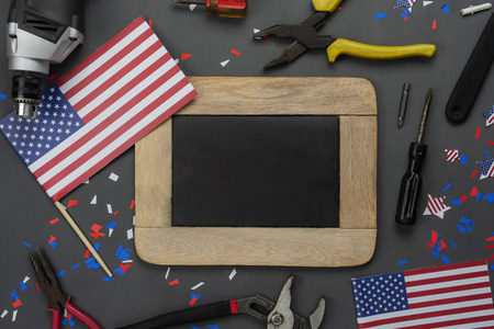 Table top view aerial image of decoration the sign of USA Happy labor day on Sep 3,2018 background concept. Flat lay accessories tools and US flag and mock up backboard on modern rustic grey wooden. Stock Photo