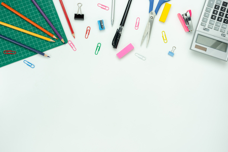Table top view aerial image of back to school of education season background or business office desk concept.Flat lay essential objects for learning or working on modern rustic white wooden plank. Stock Photo