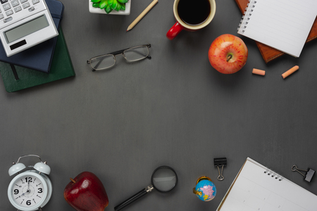 Table top view aerial image of back to school of education season background concept.Flat lay essential accessories objects on modern rustic black wooden plank.Free space for creative design.