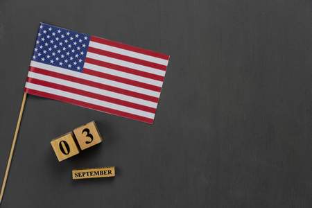 Table top view aerial image of decoration the sign of USA labor day on Sep 3,2018 background concept. Flat lay accessories US flag and date & month on modern rustic black wooden with copy space. Stock Photo