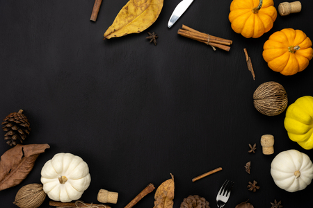 Table top view aerial image of decoration Happy Halloween or Thanksgiving day background concept.Flat lay accessory object to party the pumpkin & dry flower on black wooden.Space for creative design.