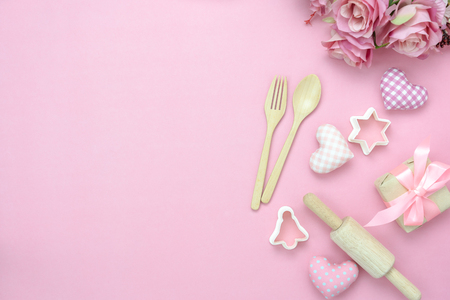 Table top view aerial image of decoration valentine's day background concept.Flat lay essential items love with cooking items with rose on modern pink paper.blank space for mock up creative design.