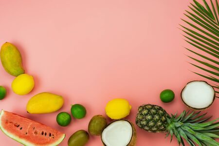 Table top view fruit tropical with spring summer holiday & vacation  background concept.Arrangement sliced various pineapple mango lemon and lime on palm green leaves.Items on pink paper.pastel. Zdjęcie Seryjne - 131764384