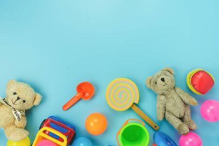 Table top view decoration kid toys for develop background concept.Flat lay accessories baby to play with items child on modern bule paper at office desk.Copy space for add text.pastel tone wallpaper.