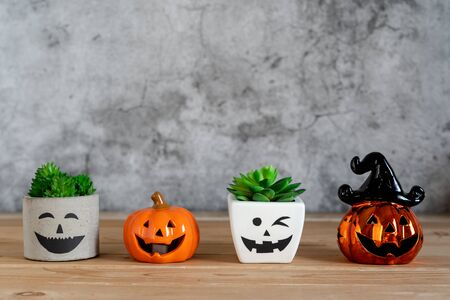 Accessories of decorations Happy Halloween day background concept.Jack O Lanterns cactus with spooky pumpkins object to party season with spider on modern rustic brown & white stone backdrop. Imagens