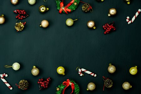 Table top view of Merry Christmas decorations & Happy new year ornaments concept.Flat lay essential difference objects gift box & fir tree on modern black paper background at home studio office desk.