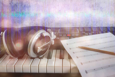 Music instruments concept background. Close up group of musical tools for musician create song with the pencil on paper note and the electronic keyboard, headphone & digital sound wave wallpaper.