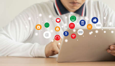 Business man wear white shirt using tablet  for digital online marketing on office desk. Business & finance technology concept.icon online e-commerce global market shopping,banking and payments.
