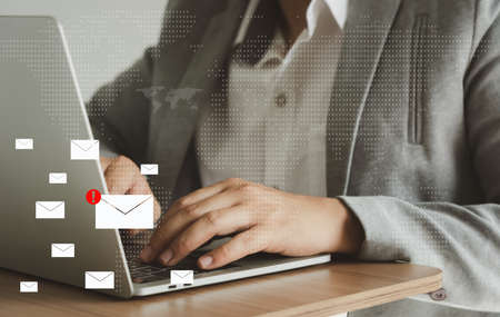 Business man using laptop about problem digital online marketing on office desk. Business - finance technology concept. icon online e-commerce. Spam email web from internet and hacker solution.