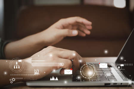 Business man using laptop for digital online marketing on office desk. Business - finance technology concept.icon online e-commerce global market shopping,banking and payments.planning and strategy.