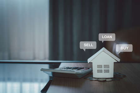 The model house white paper with message detail and calculator. Real estate property investment, mortgage agent offer, bank home loan for housing ownership, Business and Finance insurance concept.