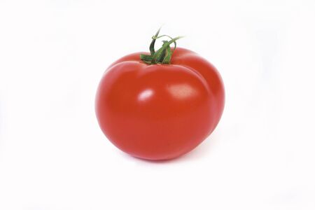 Red tomato on a white background photo