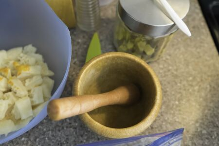Mortar and Pestle in Kitchen Stock Photo