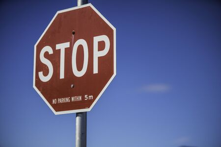 Red Stop sign at Juntion