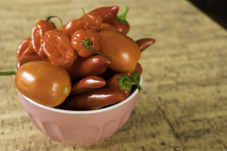 Tomatoes, Bell Peppers and Scotch Bonnet in pink bowl