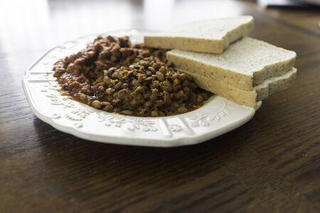 Nigerian Bean Porridge With Whole Wheat Bread - Ewa Agoyin Stock Photo