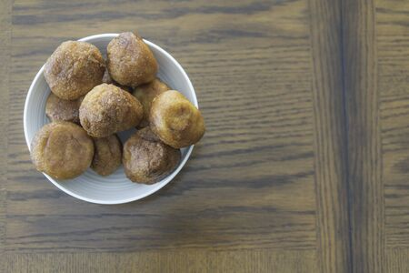Nigerian Snack Puff Puff in White Bowl with space for copy Stock Photo