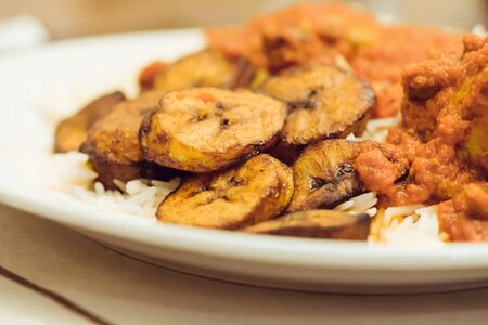 Plantain With Rice and Nigerian Pepper and Tomato Sauce