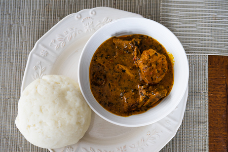 Nigerian Ogbono Soup Served with Pounded Yam Stock Photo