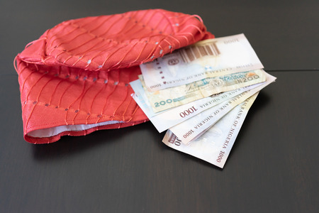 Nigerian Traditional Hat ( Filla ) with Nigerian Naira Notes Stock Photo