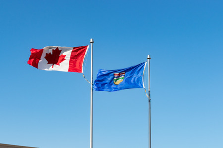 Alberta provincial flag flying with Canada Federal flag
