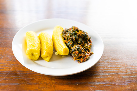 Nigerian Boiled ripe plantain with Spicy Vegetable soup