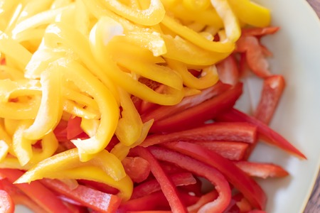Sliced and Chopped Bell Peppers ready for Cooking Stock Photo