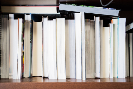 Books displayed on Bookstore bookshelves for sale Stock Photo