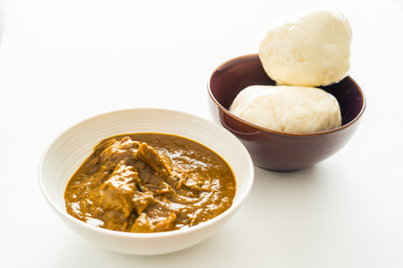 Nigerian Pounded yam wrapped in plastic served with Banga Soup
