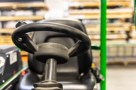 Forklift drivers wheel and seat in factory