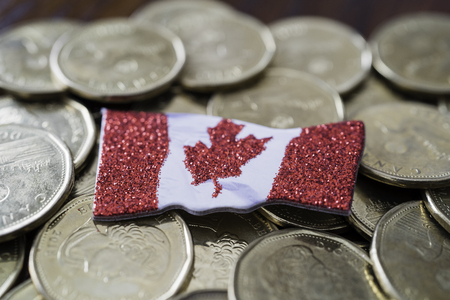 Canadian one dollar coins with a canadian flag