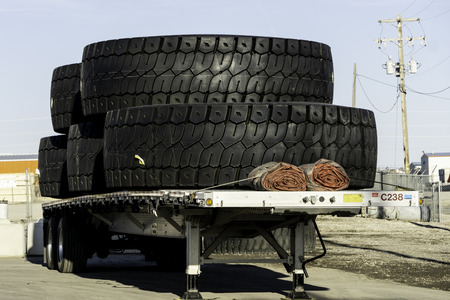 March 30 2019 - Lethbridge Alberta Canada - Huge industrial tires on the back of a truck