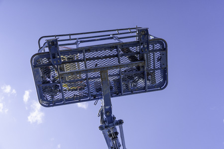 Cherry Picker Crane Underneath blue clear skies