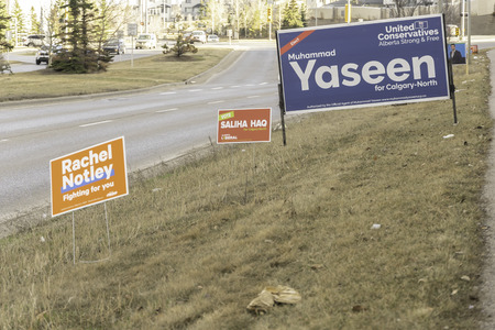 April 7 2019 - Calgary., Alberta , Canada - Candidate campaign signs on road for provincial elections