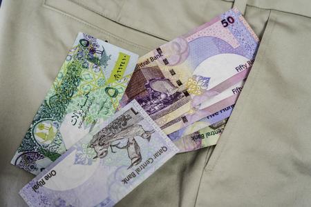 Qatari Riyal notes falling out of trouser or Pants Pockets