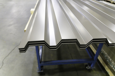 Corrugated galvanised metal roofing sheets on factory workshop