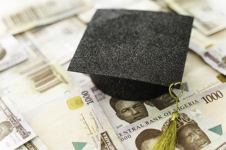 University Mortarboard academic cap on Nigerian Naira notes