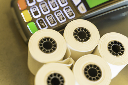 Thermal Paper Rolls with a point of sale machine