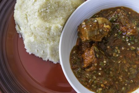 Nigerian Spicy Okro and Pepper stew served with Eba ready to eat