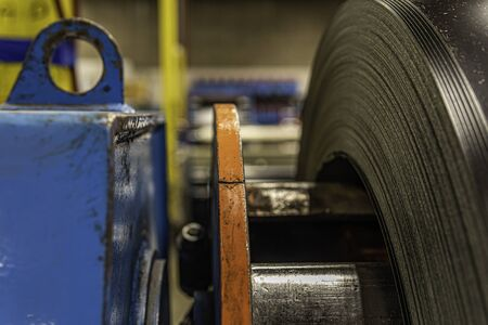 Roll of Sheet steel on machine in metalworks